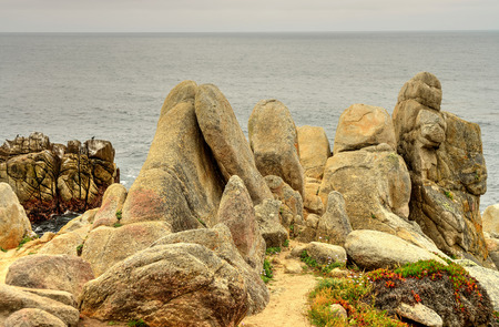 boulders: Weathered sandstone boulders at Big Sur California Stock Photo