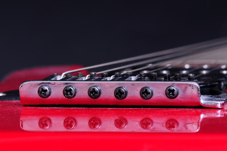 Extreme closeup macro of an electric guitar bridge