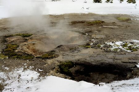 geothermal: Geothermal pool in winter Yellowstone National Park