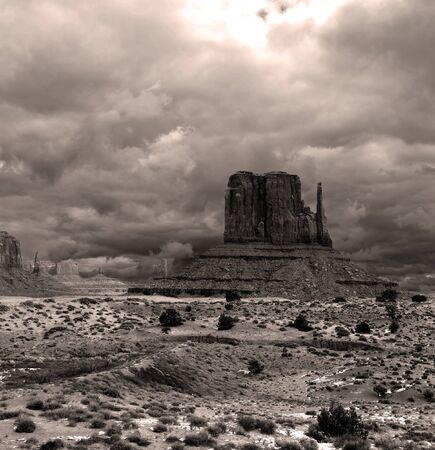navajo land: Sepia toned Monument Valley Arizona with stormy cloudy skies Stock Photo