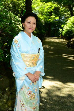 Beautiful Japanese woman wearing a light blue Kimono Stock Photo