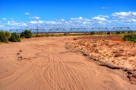 cholla: Railroad bridge Dry Gila river bed Sonora desert in central Arizona USA Stock Photo