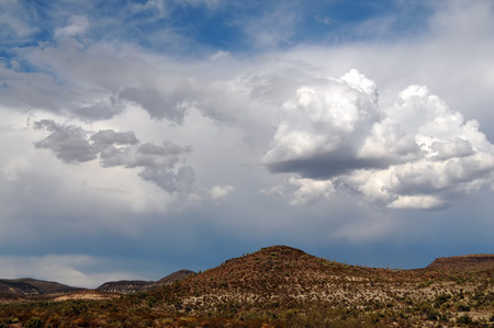 Arizona storm forming over the southwest desert mountains
