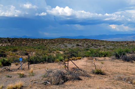 Arizona Storm forming over the southwest desert mountains 写真素材