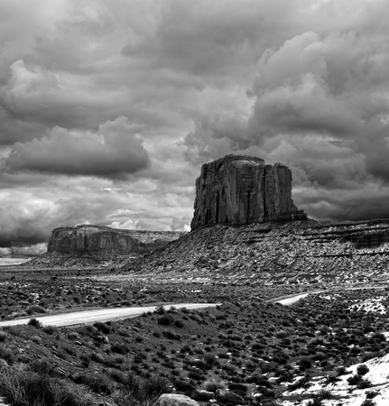 Monument Valley Arizona with stormy cloudy skies black and white