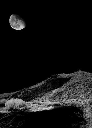 Salt River Infrared monochrome desert moon over the southwestern USA Sonora desert Arizona and mountains Stock Photo