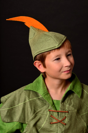 Portrait of young Robin Hood with a feather in his cap Stock Photo