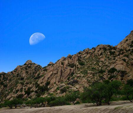 Desert moon over the southwestern USA desert and mountains