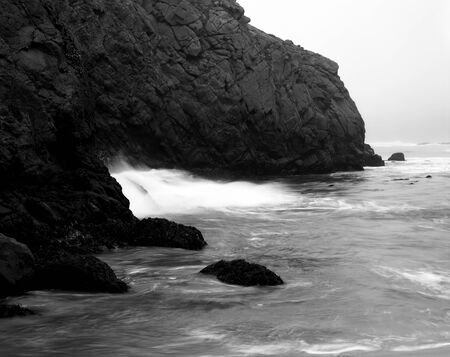 Hole through stone Pacific Ocean Big Sur California
