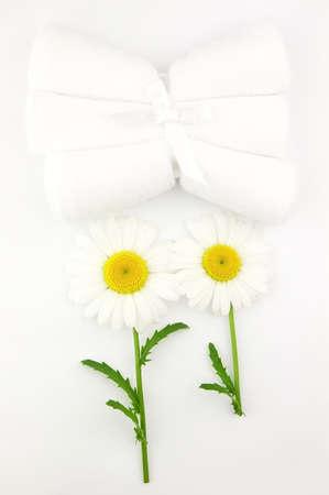 Chamomile and towels photo