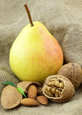 Ripe pear with sweet nuts photo