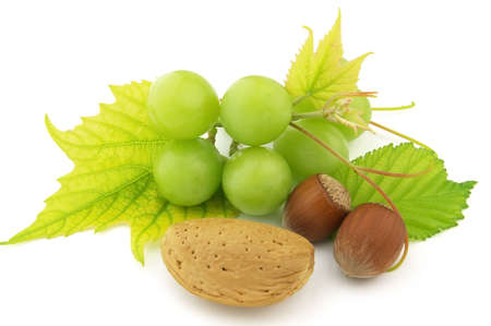 Dried nuts with grapes Stock Photo