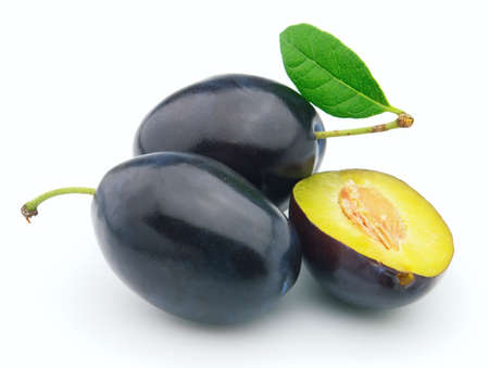 Ripe plum with leaves photo
