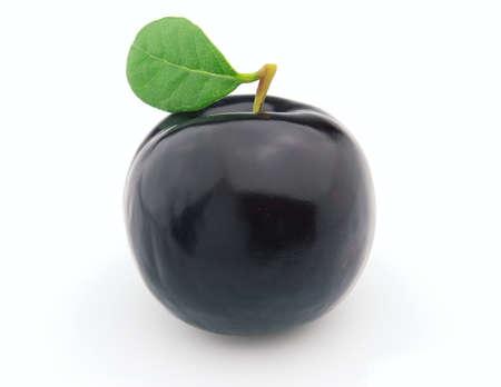 prune: Sweet ripe prune with leaves
