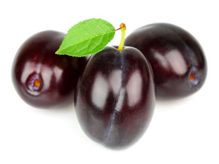 Ripe plums on a white background photo