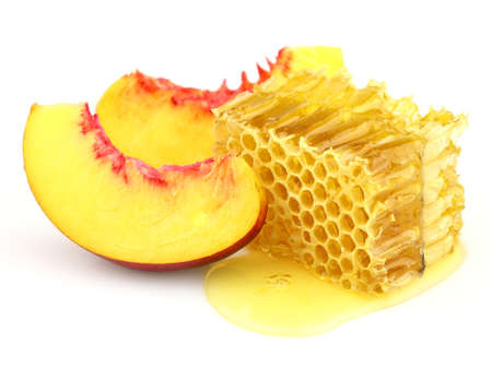 nectarine: Sweet slices of nectarine with honeycombs Stock Photo