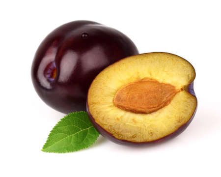Juicy plums on a white background Stock Photo