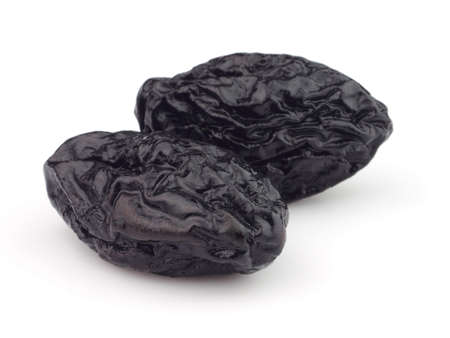 Two dried plums in closeup photo