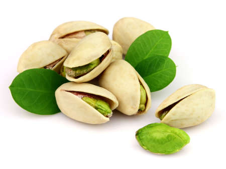 Heap of pistachio on a white background photo