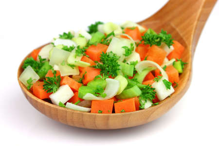 Fresh vegetables in a wooden spoon photo