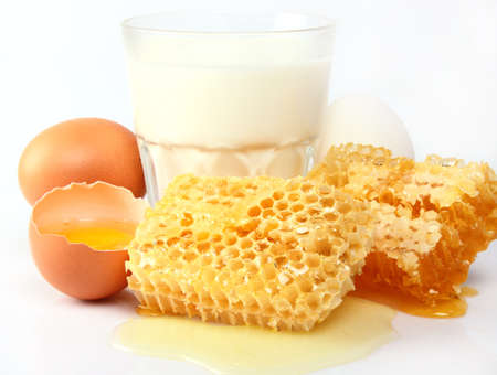 Milk with honey. Use it for a health and nutrition concept. photo