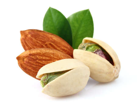 Pistachio and almonds with leaves photo
