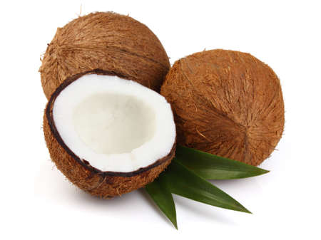 coconut milk: Coconut with leaves on a white background