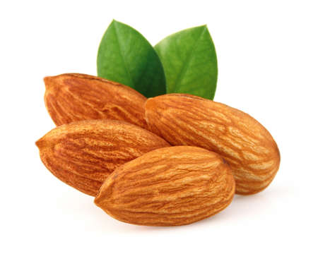 nut shell: Almonds kernel with leaves Stock Photo