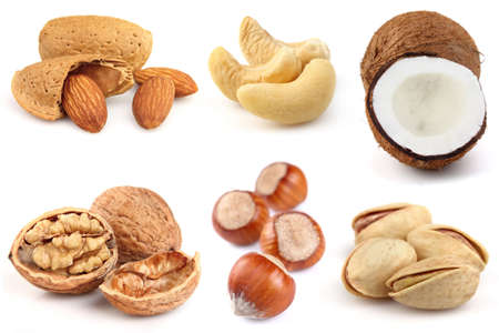 filbert nut: Collage from nuts on a white background Stock Photo