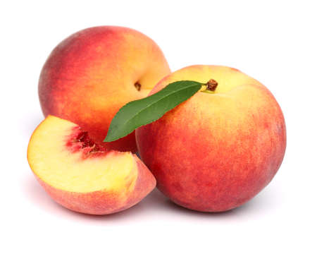 the peach: Ripe peach with leaf