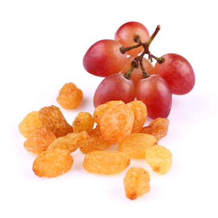 Raisins with grapes on a white background Stock Photo - 15166990
