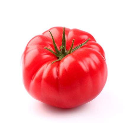Juicy tomato in closeup photo
