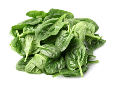 spinach: Fresh baby spinach on a white background Stock Photo