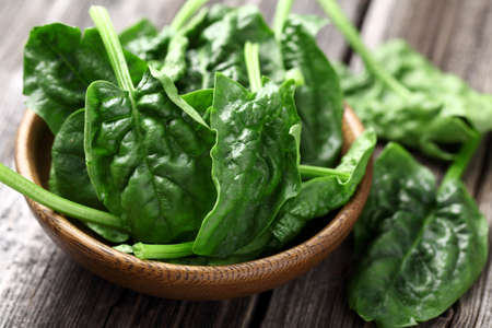 fresh spinach: Spinach leaves in a wooden plate