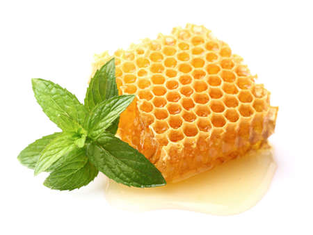 Honeycomb with mint in closeup Stock Photo