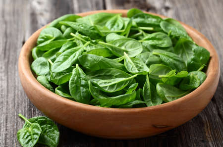 baby spinach: Baby spinach in a wooden plate