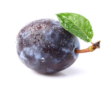 Ripe plum with leaf