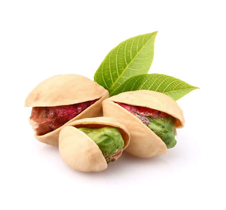 Pistachio nuts with leaves Stock Photo