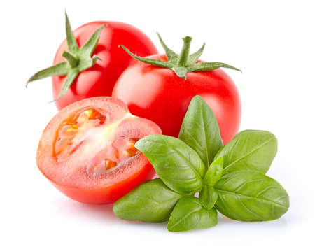 Tomato with basil Banque d'images