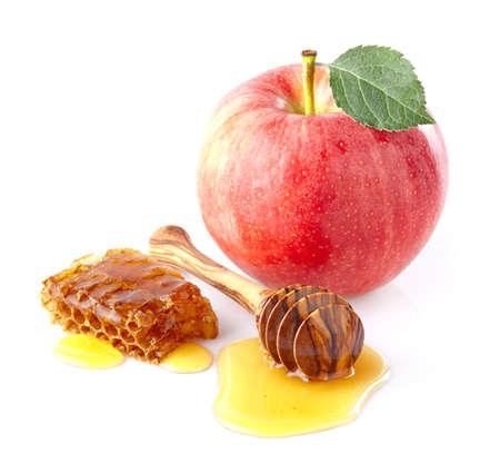 apple and honey: One apple with honey Stock Photo
