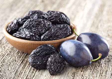 purple leaf plum: Prunes on a wooden background