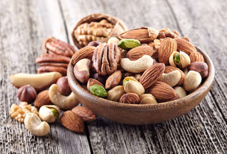 hazelnuts: Nuts mix in a wooden plate