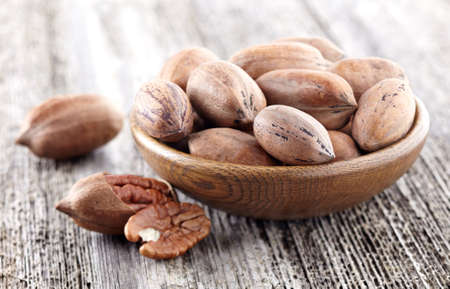 hickory nuts: Pecan nuts on a wooden background