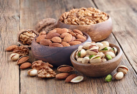 hickory nuts: Nuts in a wooden background