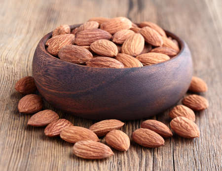 hickory nuts: Almonds kernel on a wooden background