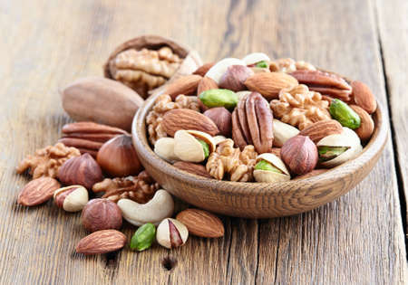 hickory nuts: Nuts on a wooden background