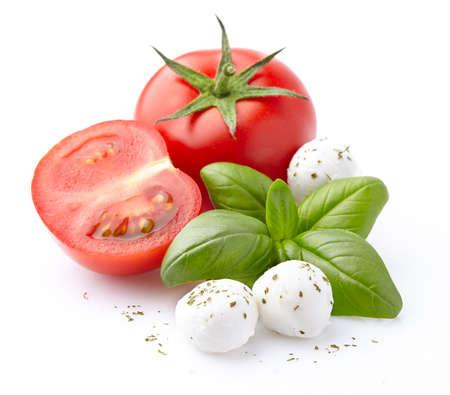 Mussarela, tomate, manjericão Foto de archivo