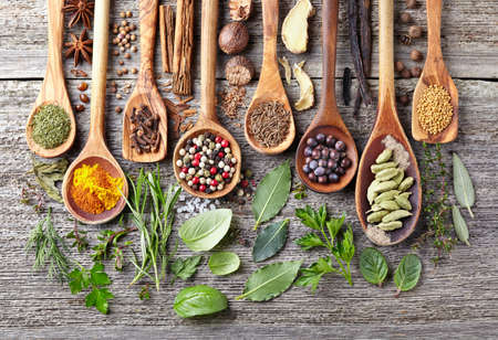 Spices and herbs on a wooden background Stockfoto
