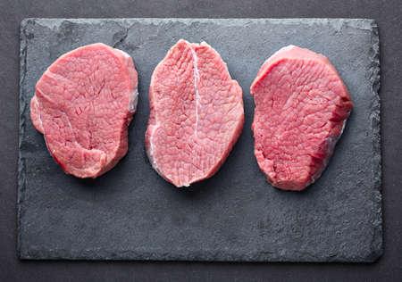 grafit: Beef steak on a graphite board