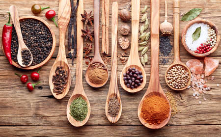 dried leaf: Spices on a wooden background Stock Photo
